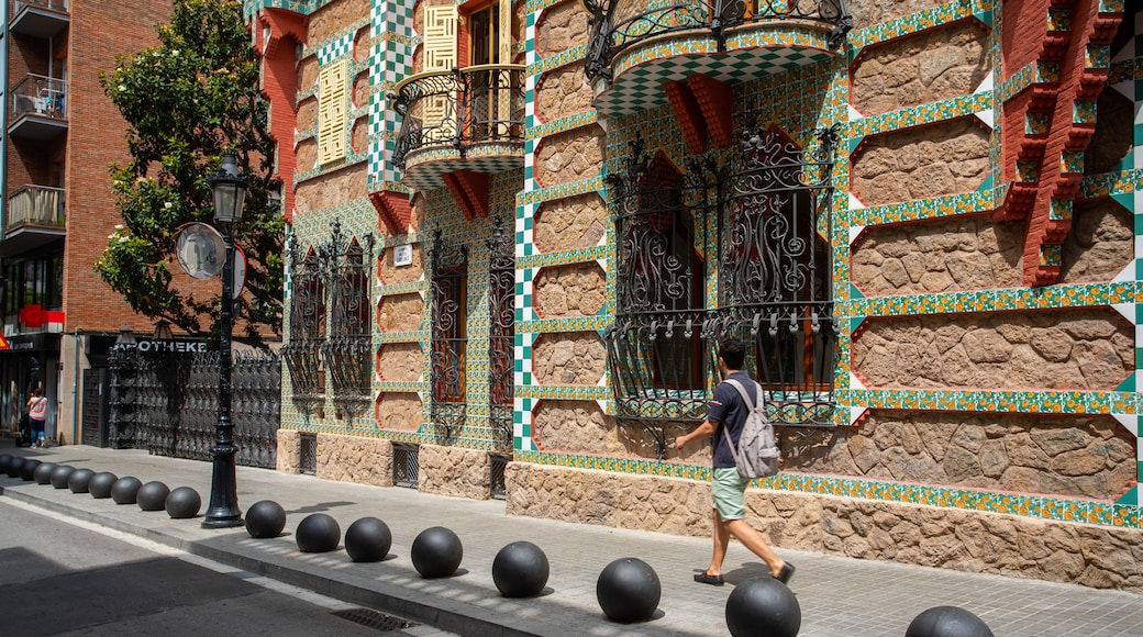 Casa Vicens featuring street scenes and heritage elements as well as an individual male