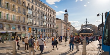 Puerta del Sol showing street scenes, a sunset and a city