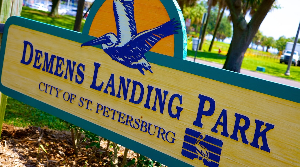 Demens Landing Park featuring signage and a park