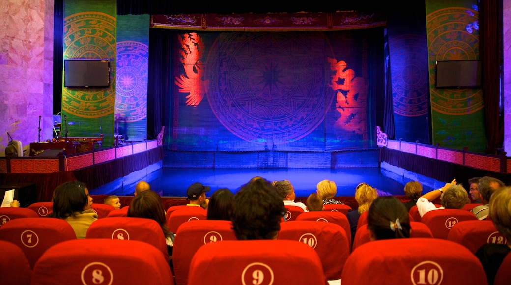Thang Long Water Puppet Theatre which includes performance art, interior views and theatre scenes