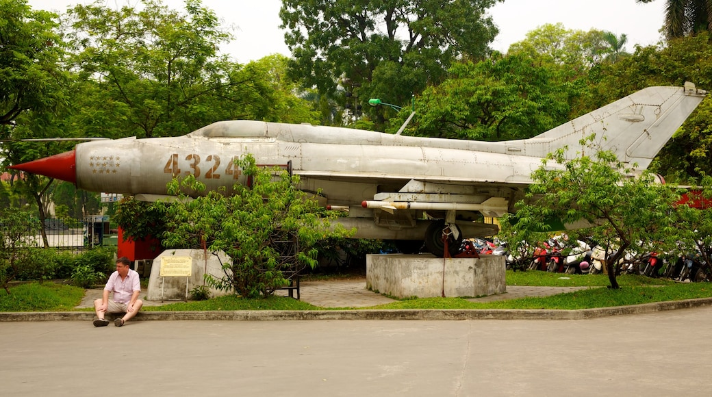 Hanoi War Museum featuring aircraft and military items as well as an individual male