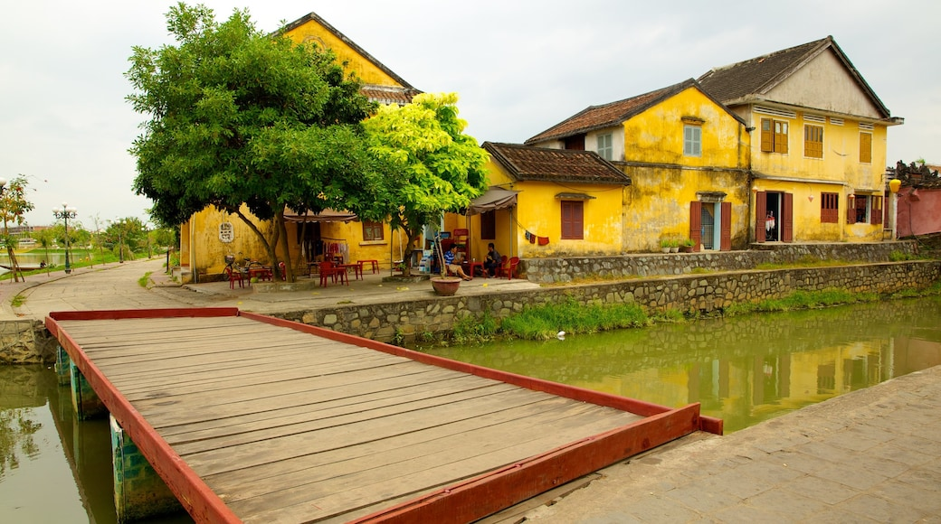 Hoi An Ancient Town featuring a river or creek, a bridge and a small town or village