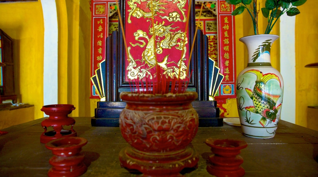 Cam Pho Temple showing religious elements, a temple or place of worship and interior views