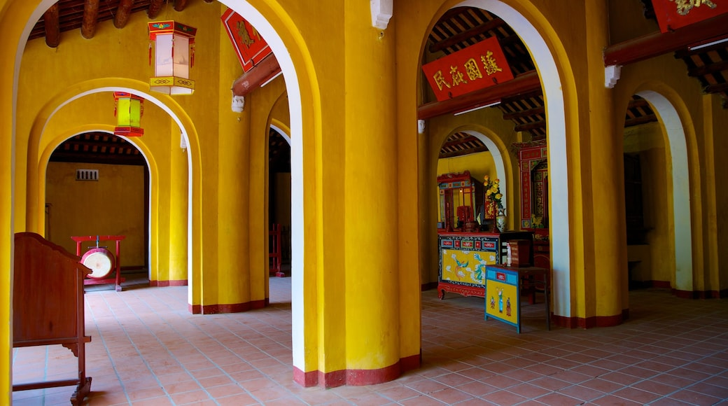 Cam Pho Temple featuring heritage architecture, a temple or place of worship and interior views