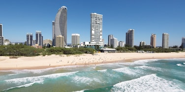 Broadbeach featuring skyline, a sandy beach and a high-rise building