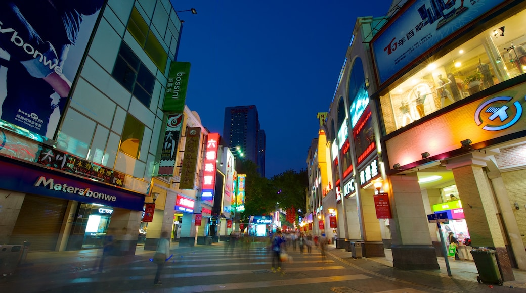 Beijing Road Pedestrian Street showing signage, night scenes and modern architecture
