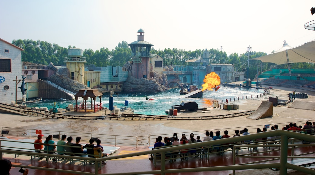 Chimelong Paradise showing rides as well as a large group of people