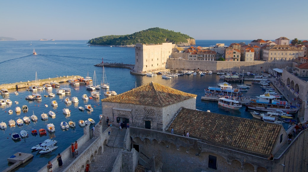 Dubrovnik - Southern Dalmatia featuring a marina, a coastal town and heritage architecture