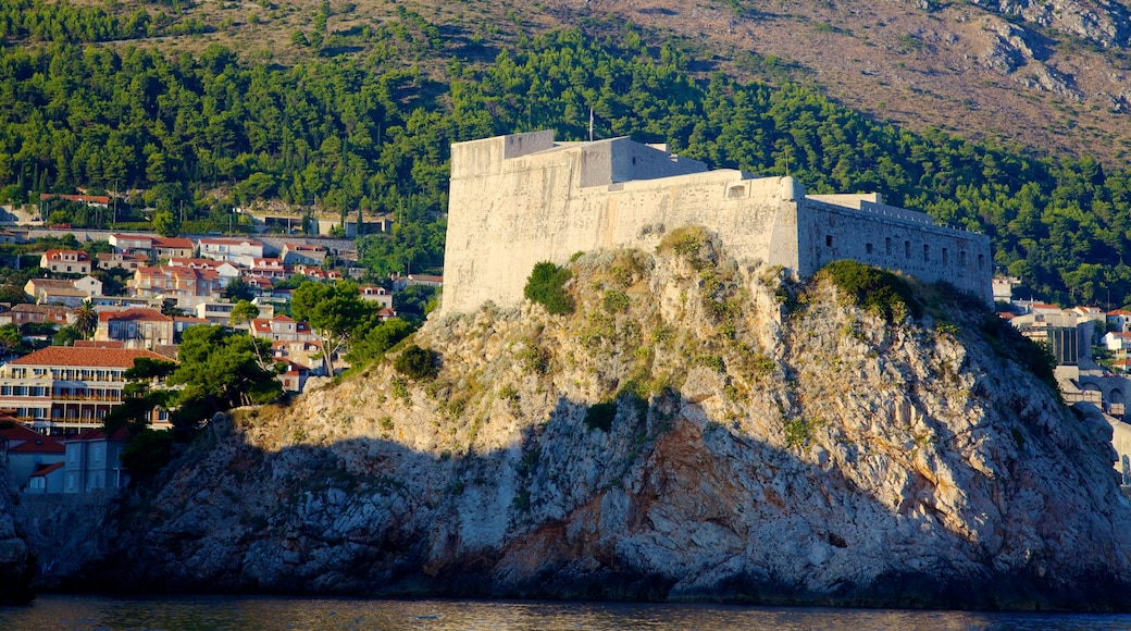 Dubrovnik - Southern Dalmatia featuring rocky coastline, heritage architecture and a small town or village