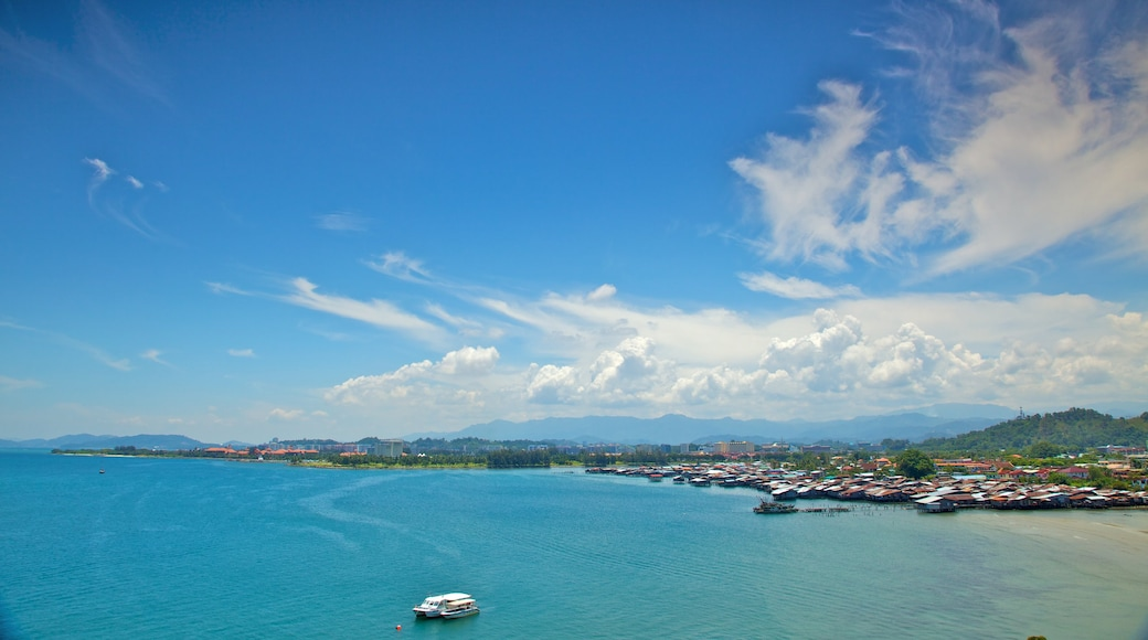 Kota Kinabalu showing a marina, a bay or harbour and tropical scenes