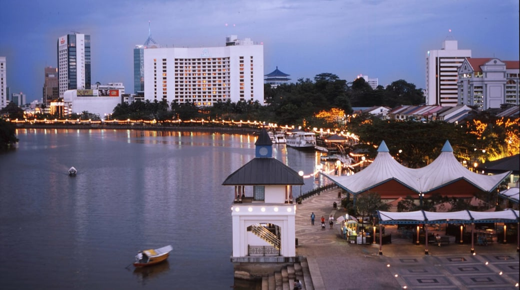 Kuching featuring a bay or harbour, boating and a coastal town