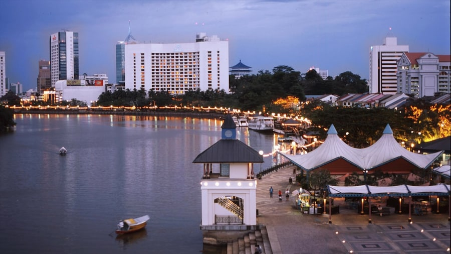 Kuching which includes a coastal town, cbd and boating