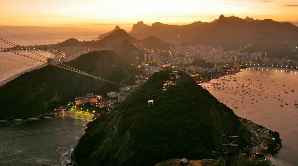 Rio de Janeiro featuring general coastal views, mountains and a sunset