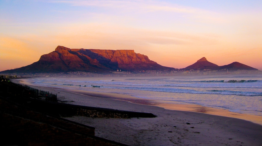 Table Mountain showing a sunset, mountains and a beach