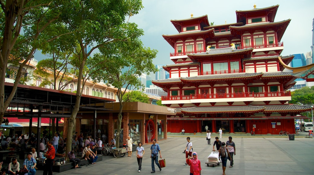 Chinatown showing a temple or place of worship, heritage architecture and street scenes