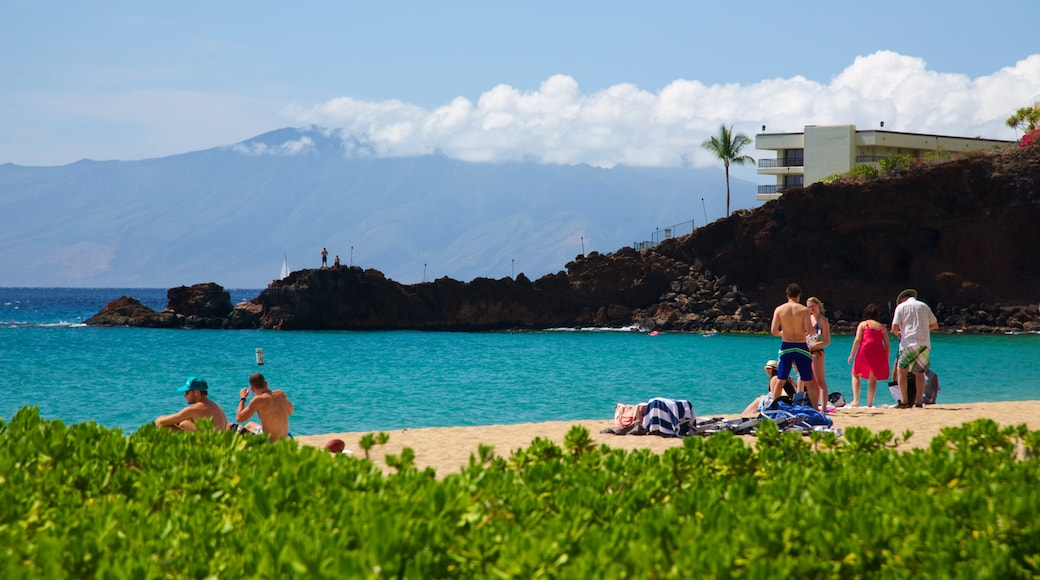 Kaanapali Beach showing a beach, a luxury hotel or resort and mountains
