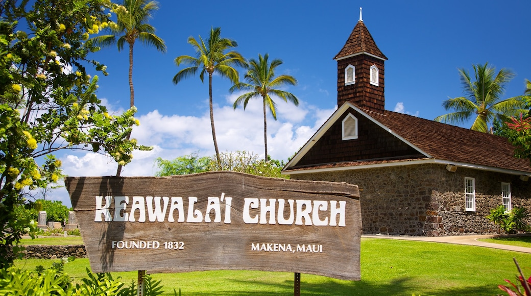Maluaka Beach showing signage, a church or cathedral and a garden