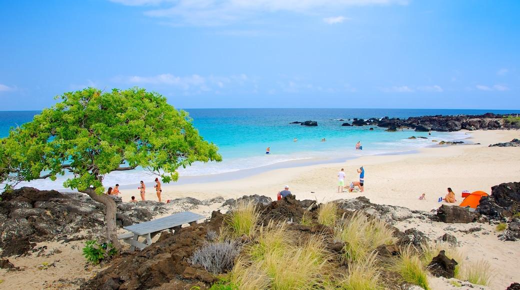 Kua Bay featuring a coastal town and a beach