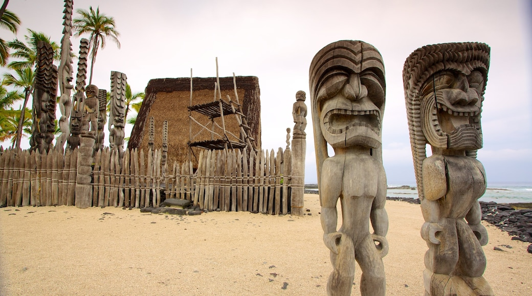 Pu\'uhonua o Honaunau National Historical Park featuring a statue or sculpture and a sandy beach