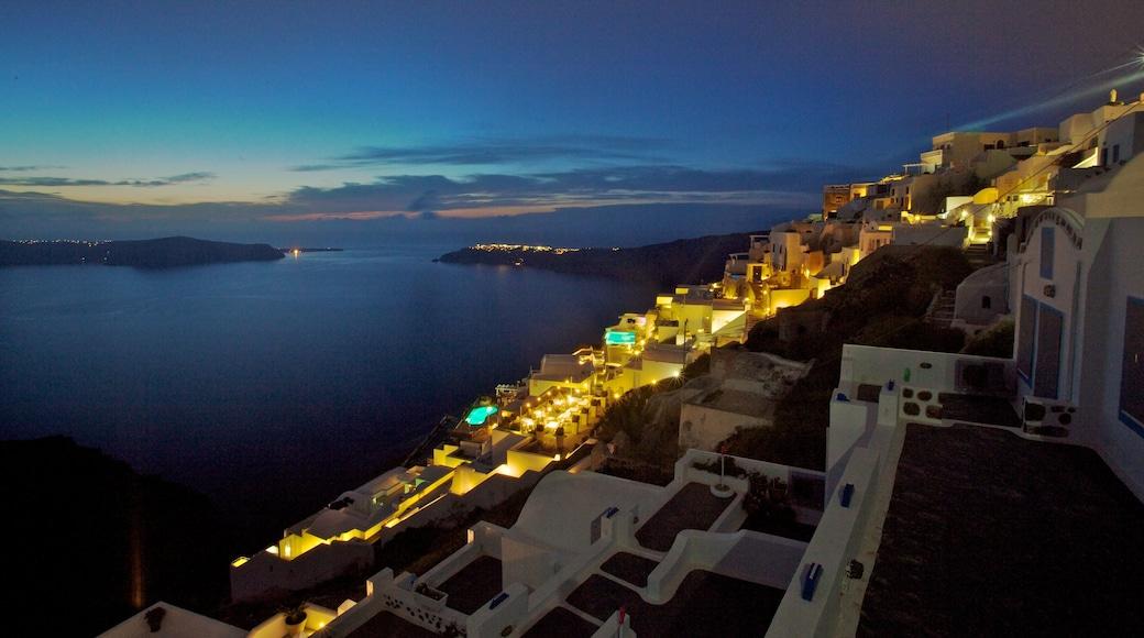 Fira showing a sunset, a coastal town and general coastal views