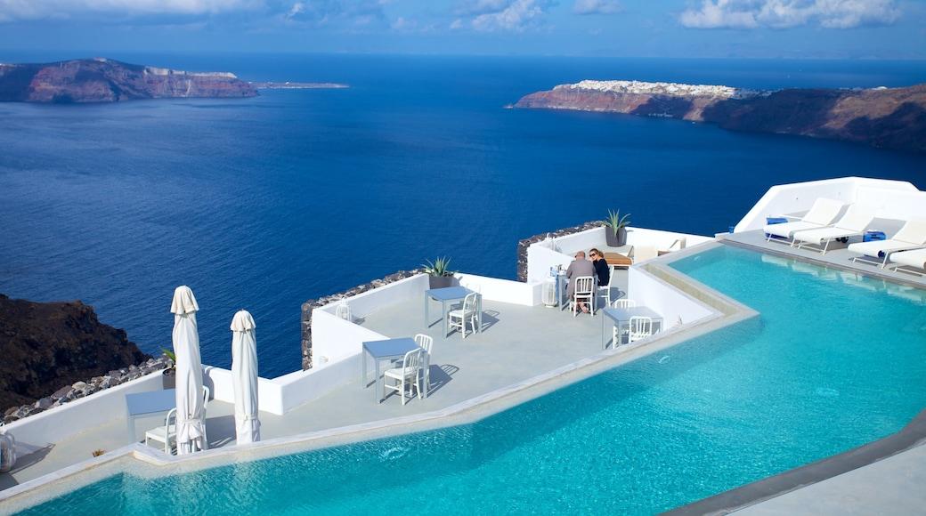 Firá showing a pool, general coastal views and views