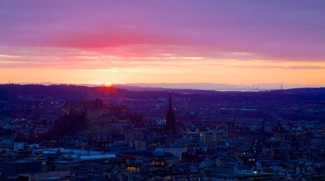 Arthur\'s Seat showing skyline, a sunset and a city
