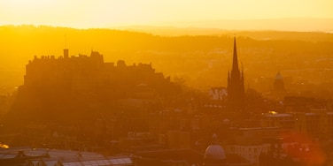 Arthur\'s Seat which includes views, a city and a sunset