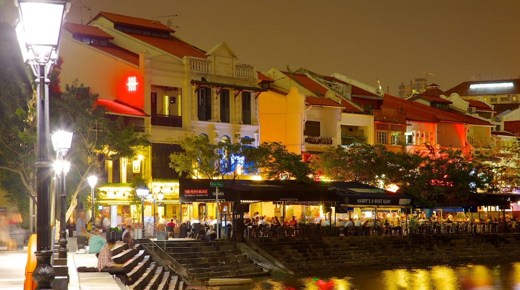 Boat Quay showing night scenes, street scenes and a house