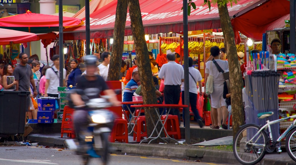 Bugis Street Shopping District showing street scenes, a city and motorcycle riding