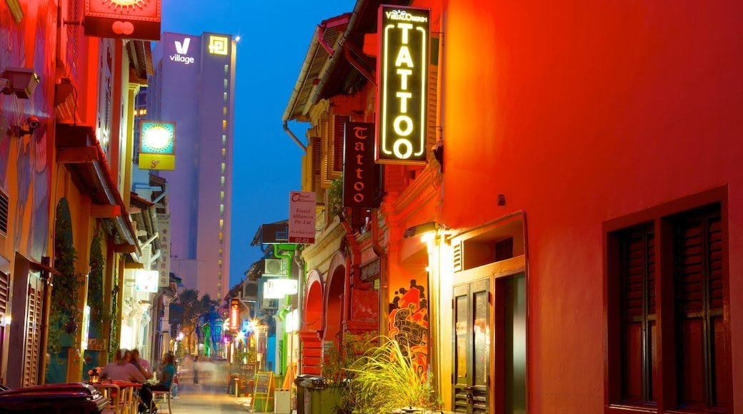 Haji Lane featuring signage, street scenes and night scenes