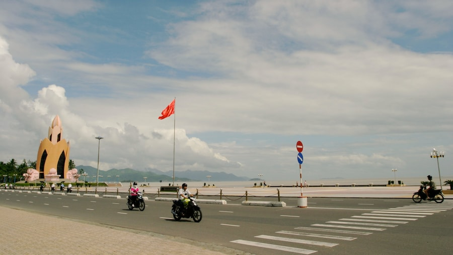 Nha Trang featuring motorbike riding, a coastal town and street scenes