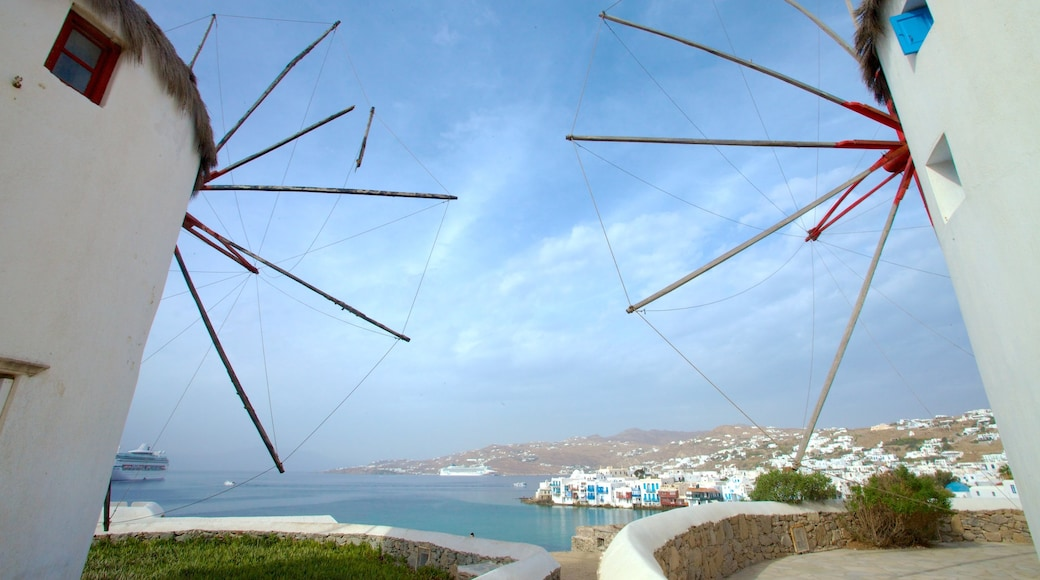 Windmills of Mykonos featuring a windmill, heritage architecture and a coastal town