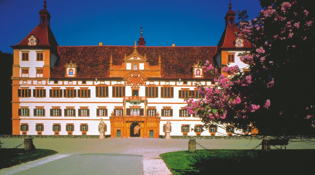 Eggenberg Palace which includes a square or plaza, flowers and chateau or palace