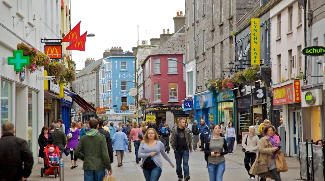 Galway featuring signage, street scenes and a city