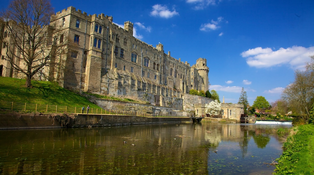 Warwick Castle which includes chateau or palace, a river or creek and heritage architecture