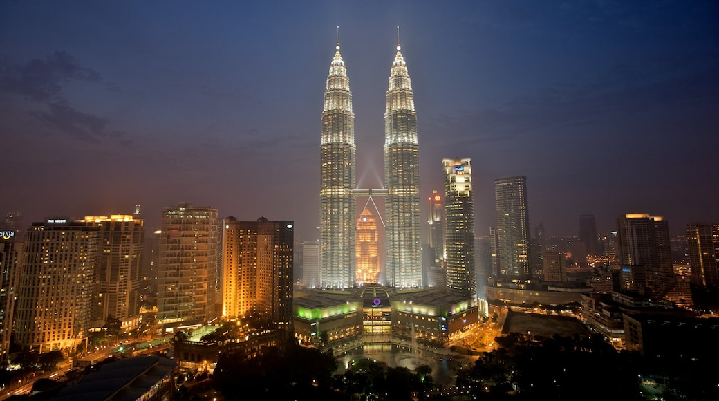 Petronas Twin Towers featuring a city, a skyscraper and night scenes