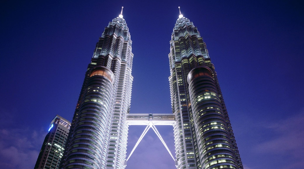 Petronas Twin Towers featuring a skyscraper, night scenes and cbd