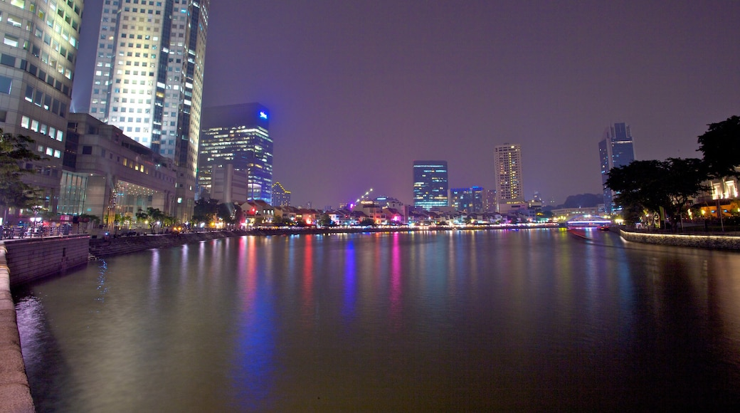 Boat Quay which includes a high-rise building, a bay or harbour and night scenes