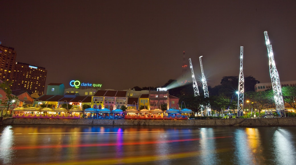 Clarke Quay which includes general coastal views, night scenes and central business district
