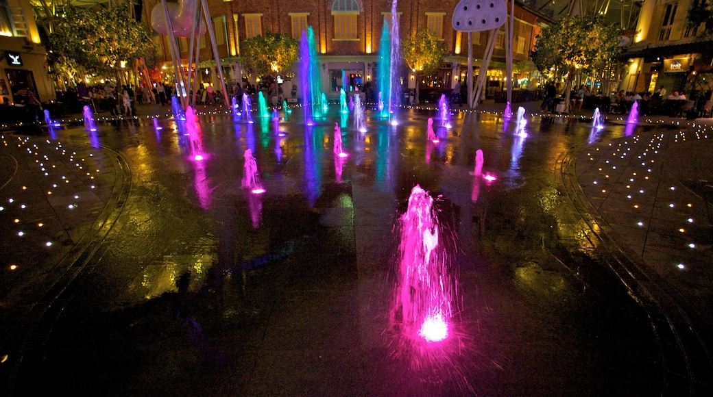 Clarke Quay which includes nightlife, a park and night scenes