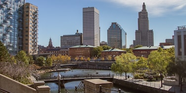 Providence featuring a bridge, a river or creek and modern architecture