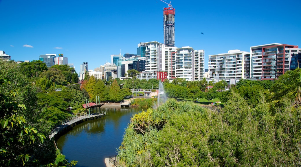 Roma Street Parkland showing a garden, a city and a river or creek