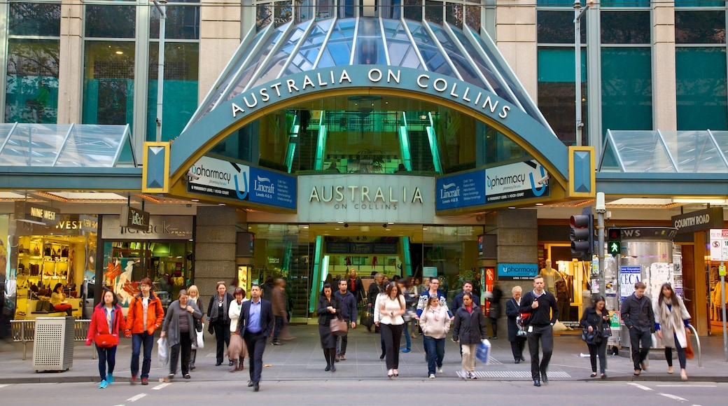 Collins Street which includes street scenes, modern architecture and signage