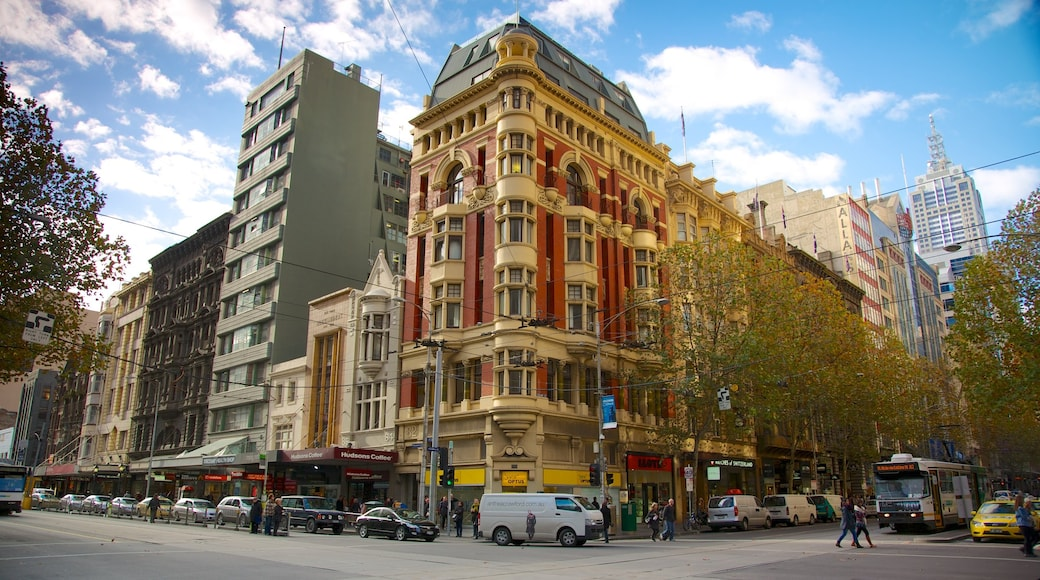 Collins Street which includes a city, heritage architecture and street scenes