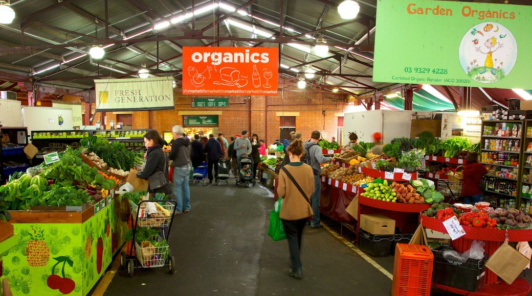 Queen Victoria Market featuring markets, food and interior views