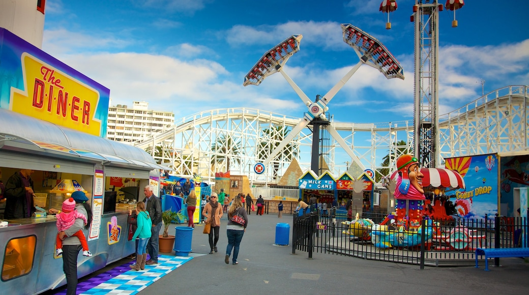 Luna Park which includes rides and signage as well as a large group of people