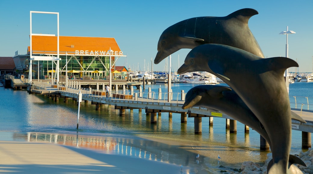 Hillarys Boat Harbour showing outdoor art, a bay or harbor and a coastal town