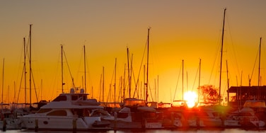 Hillarys Boat Harbour featuring a bay or harbour, boating and a sunset