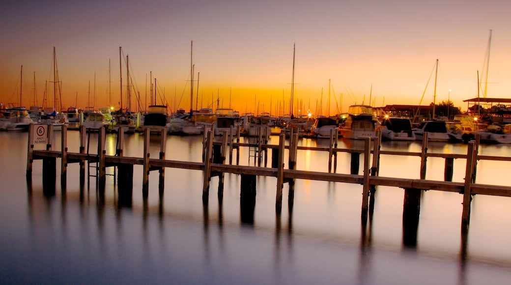 Hillarys Boat Harbour showing a coastal town, a sunset and a bay or harbor