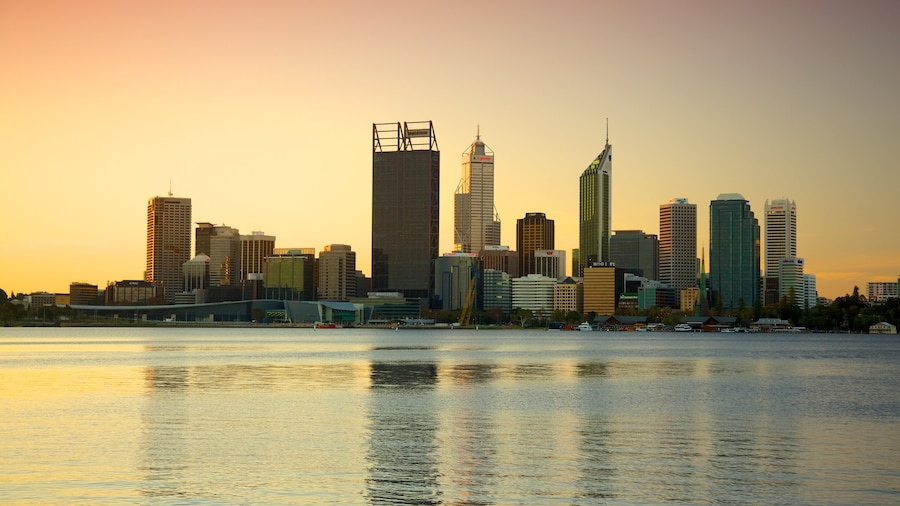 Perth featuring a sunset, central business district and general coastal views